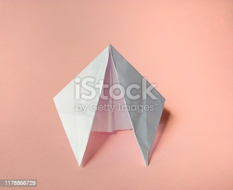 658921430 istock photo Paper spaceship on pink background. funny concept 1178866729