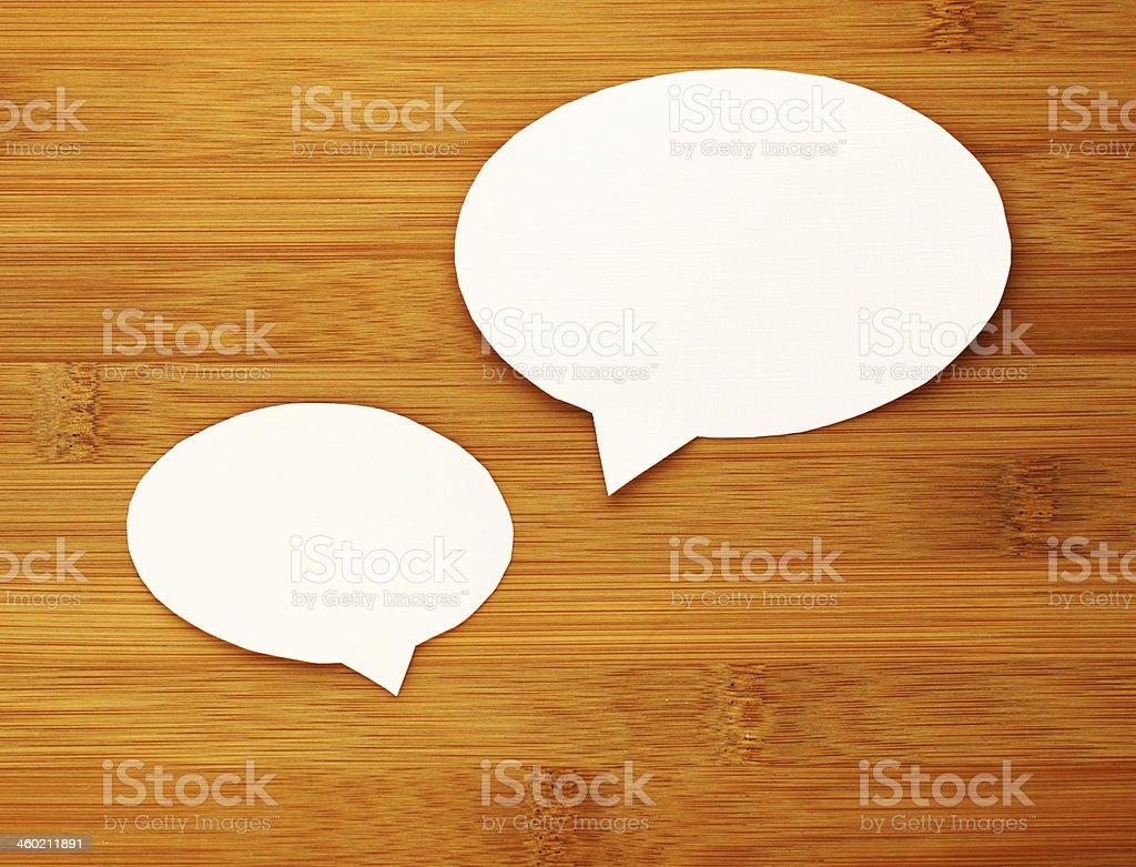 paper speech bubble on wood background stock photo