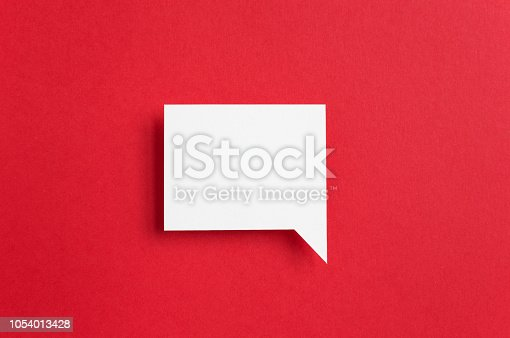 paper speech bubble on red background