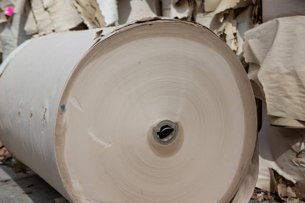 Paper spools.  Waste paper in the yard,  recycling. stock photo
