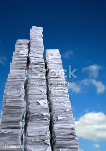 Stacks of paper against a blue sky