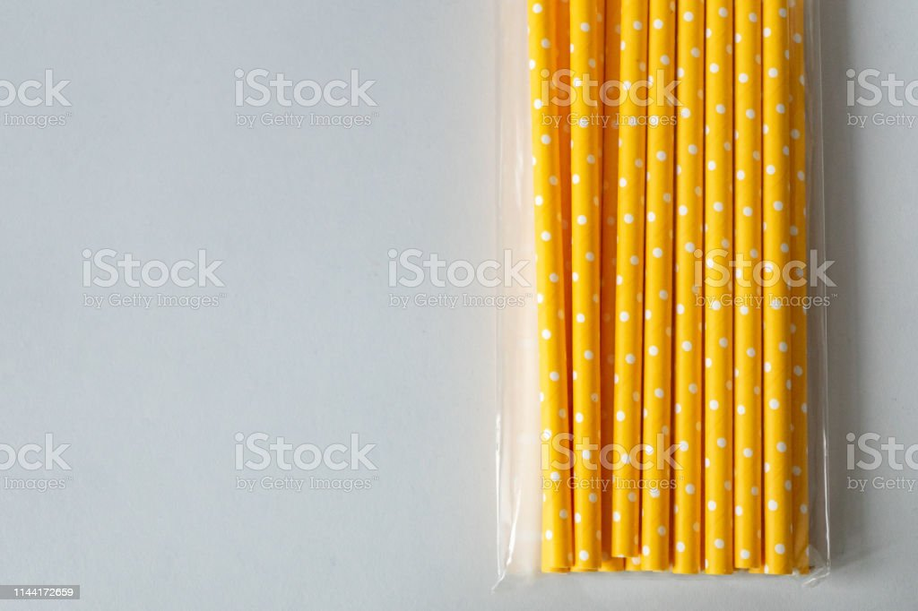 paper straws in plastic packaging isolated on white background