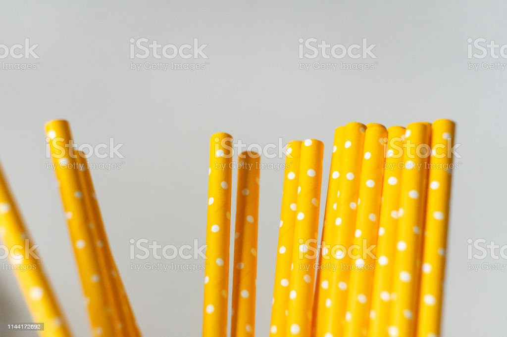 Yellow paper straws isolated on white background