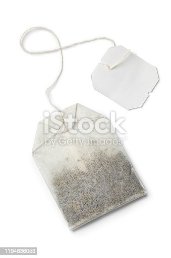 Paper tea bag with empty label isolated on white background