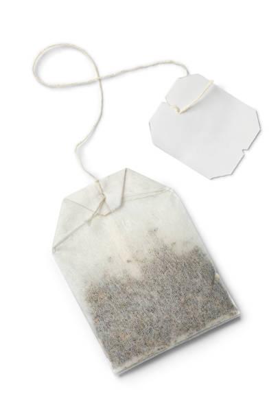 Paper tea bag with empty label stock photo