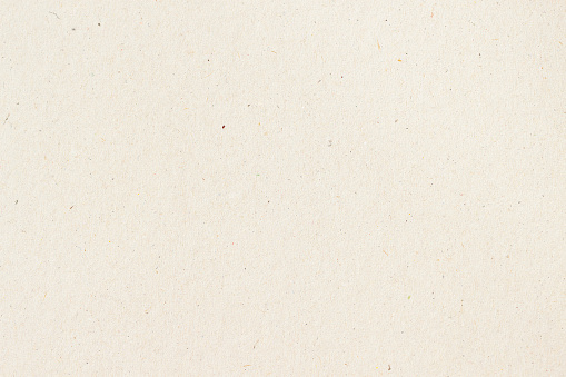 Paper texture cardboard background close-up. Cream light grunge old paper surface texture