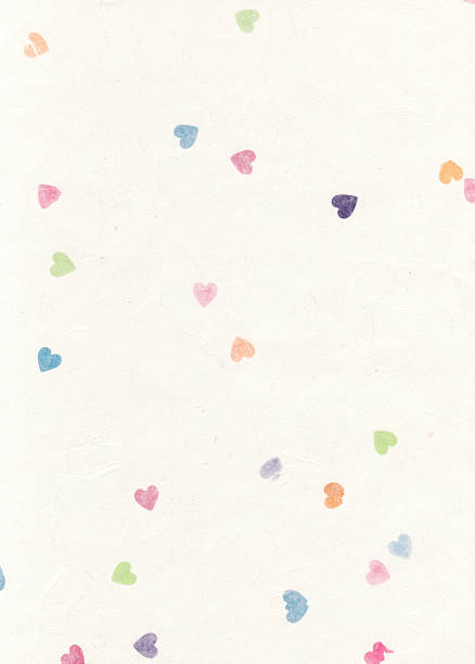 Paper texture with coloured hearts stock photo