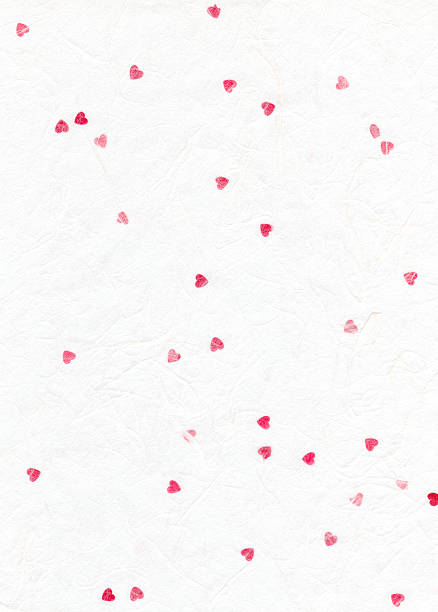 Paper texture with red hearts stock photo