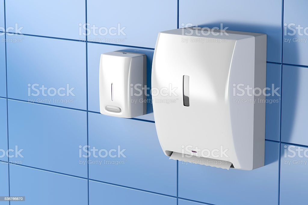 Paper towel and soap dispensers stock photo