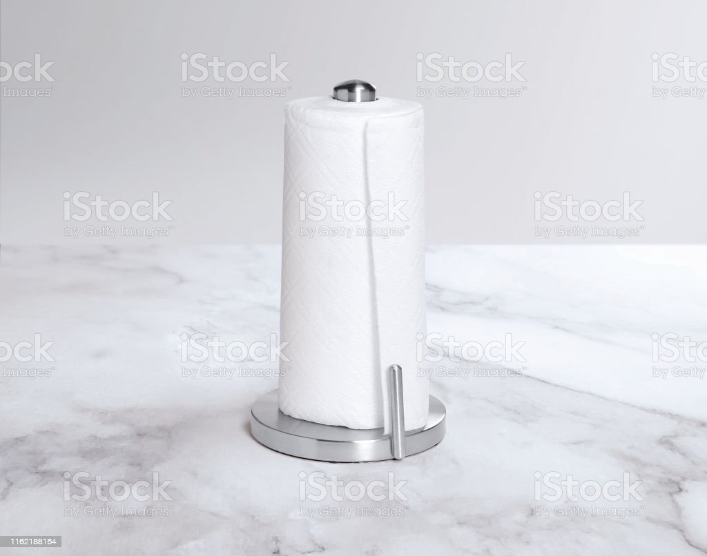 Picture of: Paper Towel Holder On A White Marble Countertop Stock Photo Download Image Now Istock