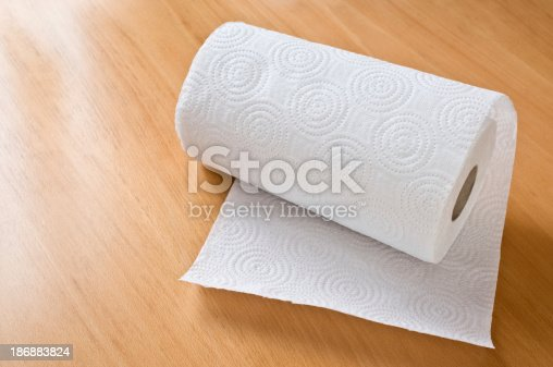 Paper towel roll on the table.
