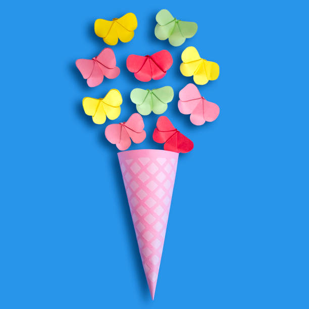 Paper waffle cone with butterflies stock photo