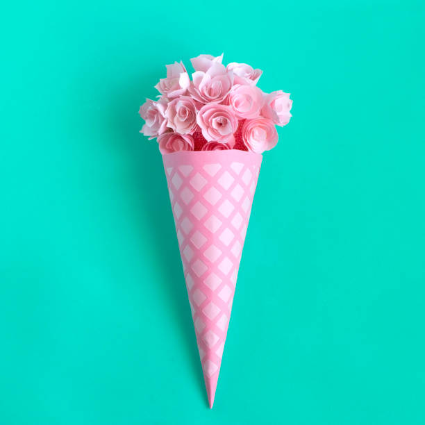 Paper waffle cone with flowers stock photo