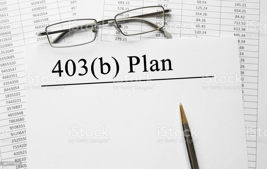Paper with 403 b plan on a table stock photo
