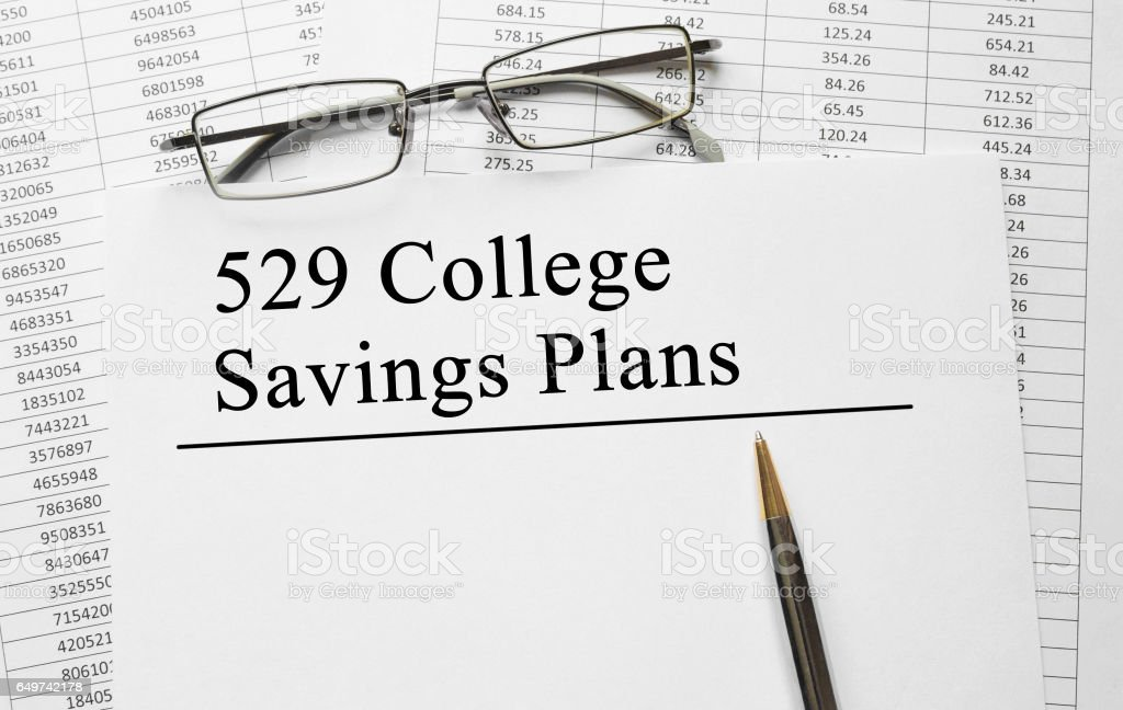 Paper with 529 College Savings Plans on a table stock photo