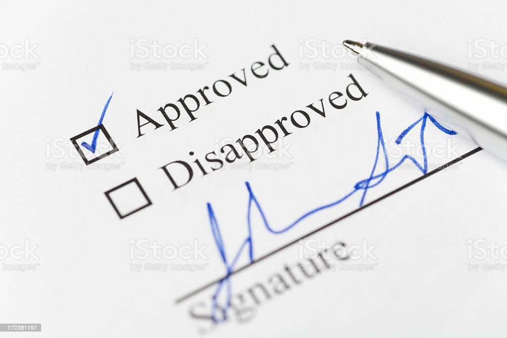 Paper with a tick next to word 'approved' with signature royalty-free stock photo