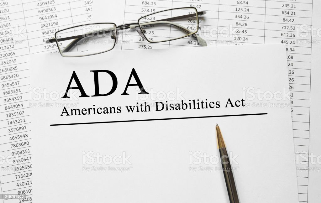 Paper with Americans with Disabilities Act ADA on a table stock photo