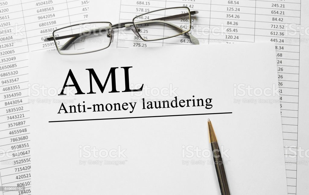 Paper with Anti-money laundering AML on a table stock photo