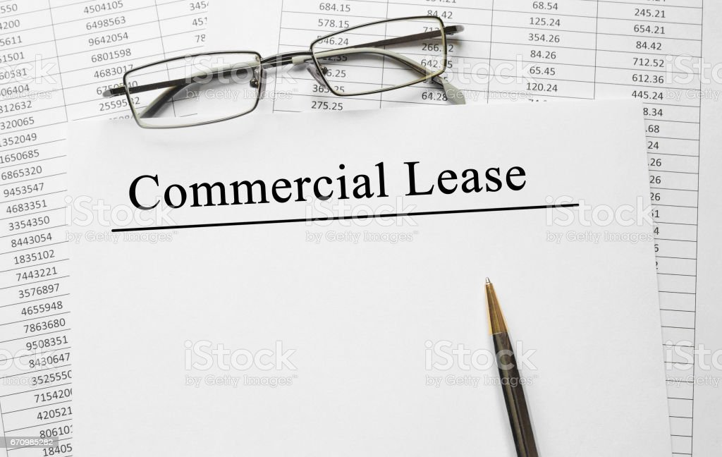 Paper with Commercial Lease on a table stock photo