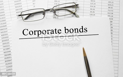 istock Paper with Corporate Bonds on a table 664268234
