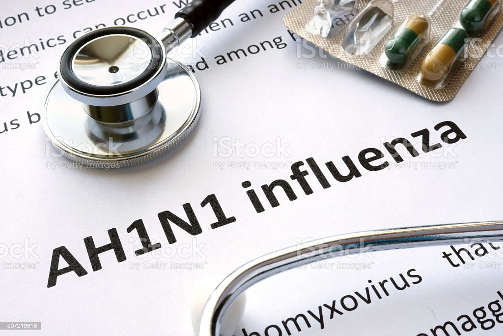 Paper with diagnosis AH1N1 influenza and stethoscope. stock photo