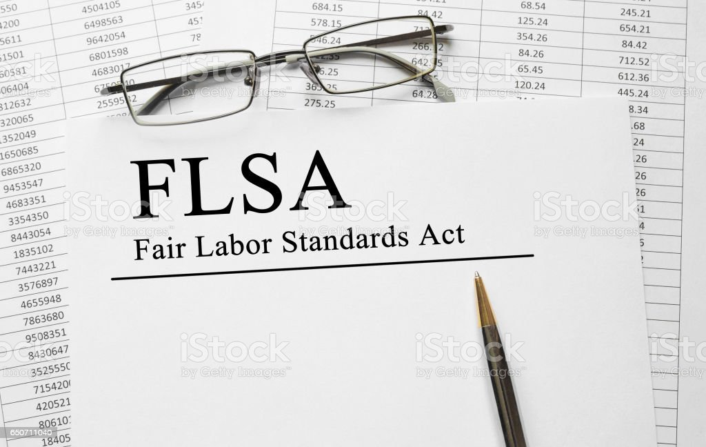 Paper with Fair Labor Standarts Act FLSA on a table stock photo