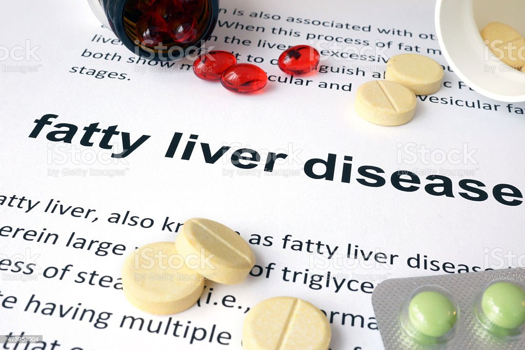 Paper with fatty liver disease and pills. stock photo