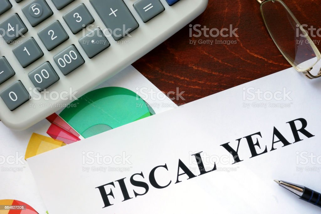 Paper with Fiscal year and charts. stock photo