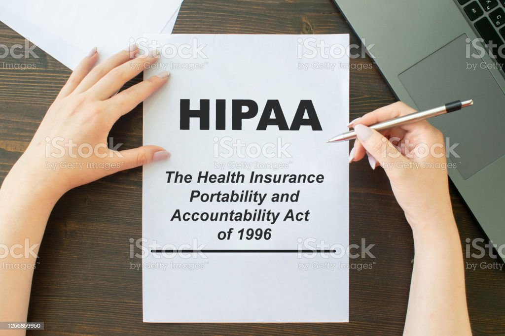 Paper With Hipaa The Health Insurance Portability And Accountability Act Of 1996 On A Table ...