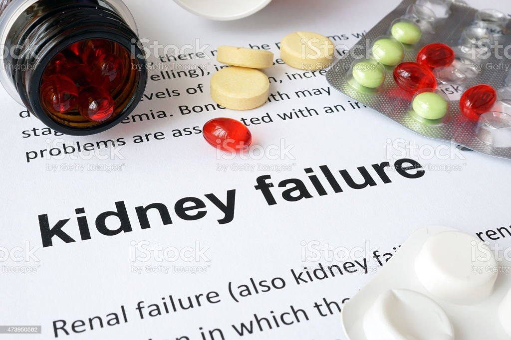 Paper with kidney failure and pills. stock photo