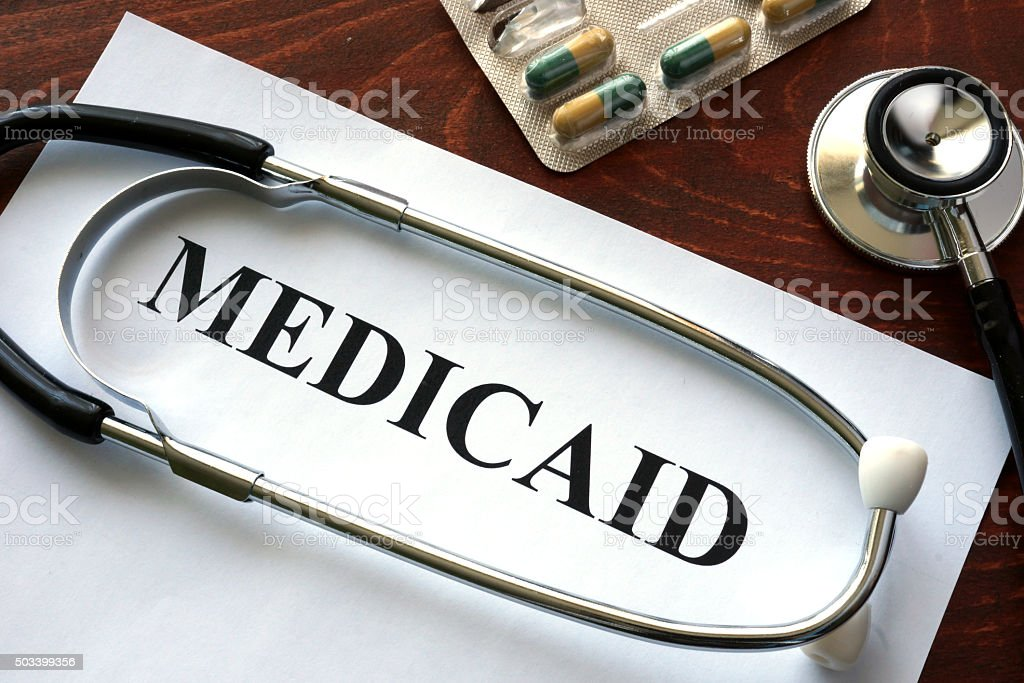 Paper with Medicaid and stethoscope. Medical insurance concept. stock photo