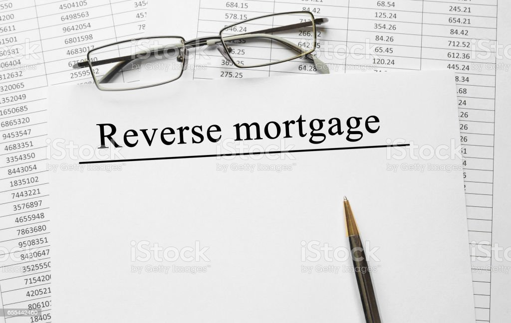 Paper with Reverse Mortgage on a table stock photo