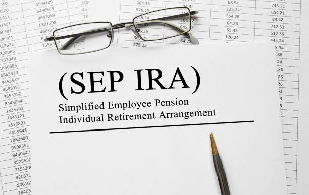Paper with Simplified Employee Pension Individual Retirement Arrangement SEP IRA on a table Paper with Simplified Employee Pension Individual Retirement Arrangement SEP IRA on a table 40 kilometre stock pictures, royalty-free photos & images