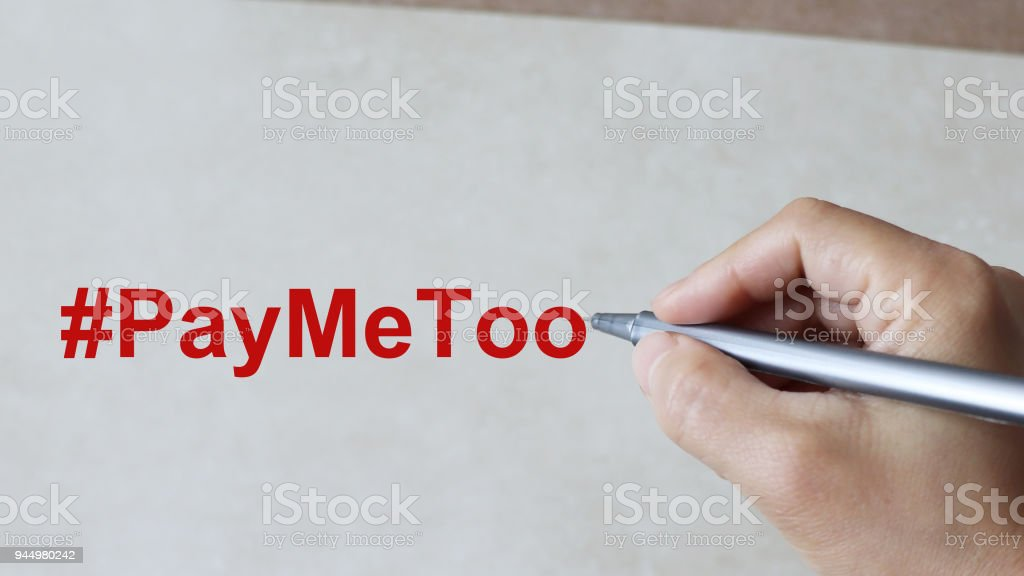 A Paper with the text #PayMeToo. stock photo