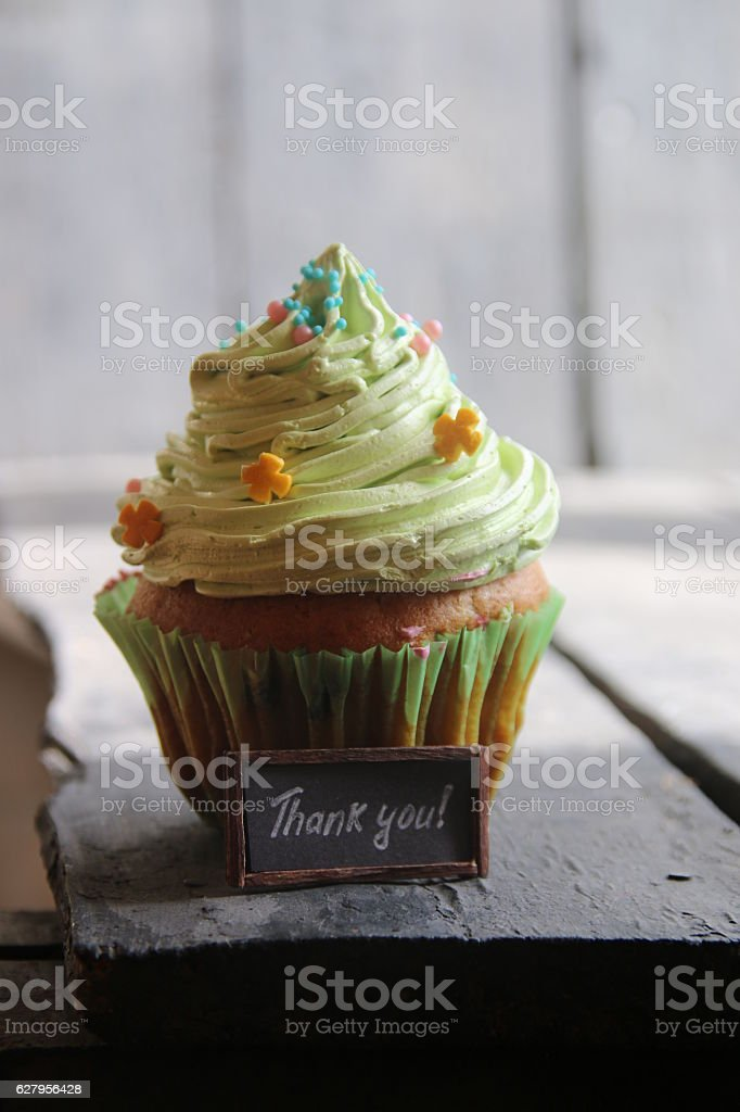 paper with the words Thank You and cake stock photo