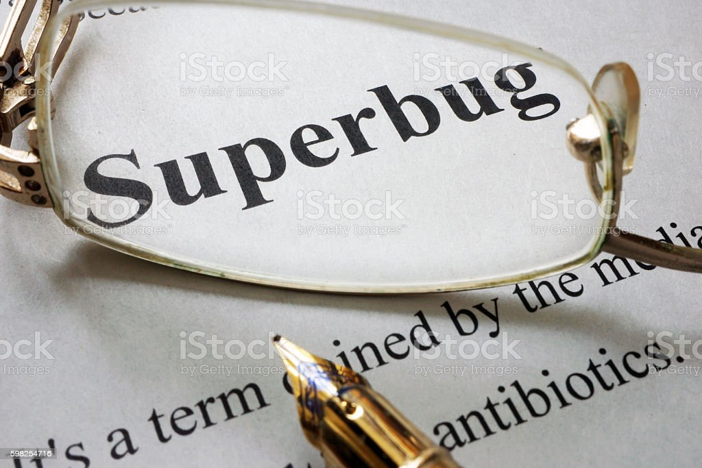 Paper with word superbug and glasses. stock photo