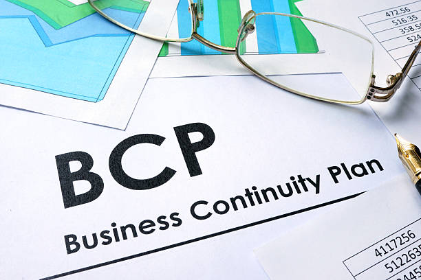 paper with words bcp business continuity plan - continuité photos et images de collection