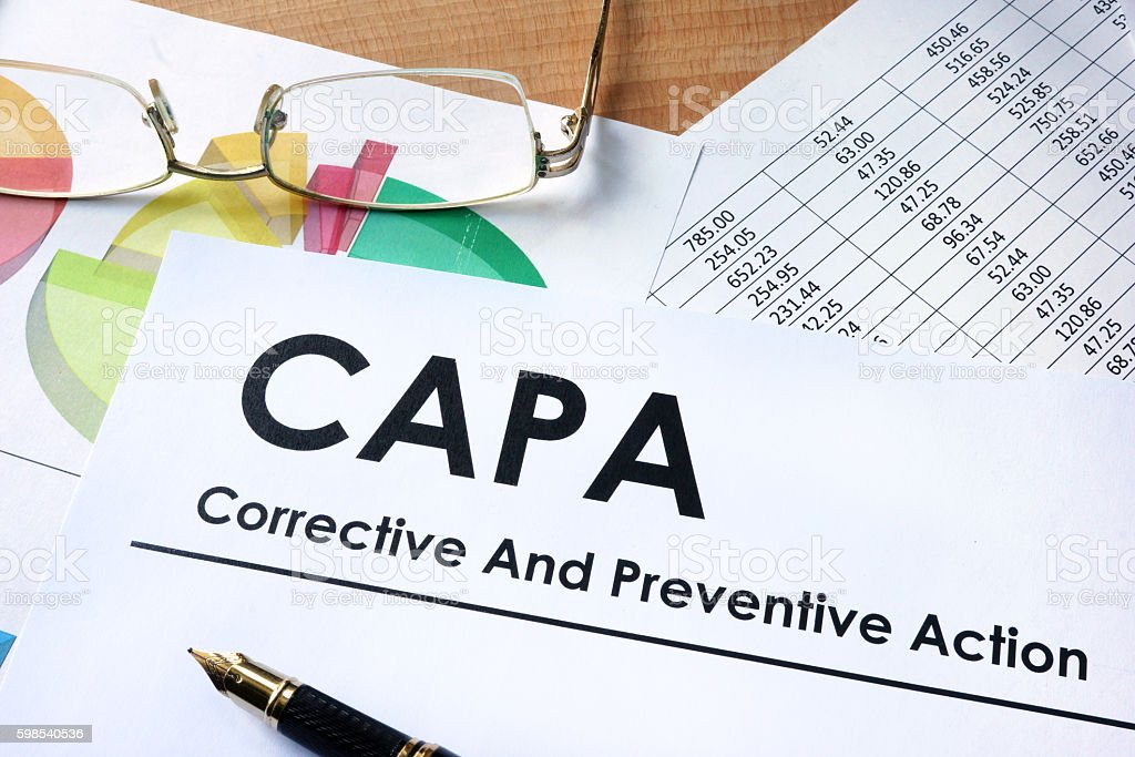 Paper with words CAPA Corrective and Preventive action plans stock photo