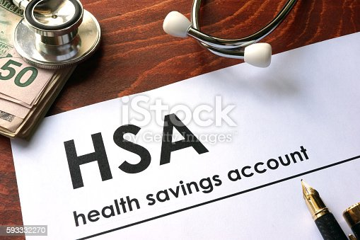 istock Paper with words  health savings account (HSA) on a table. 593332270
