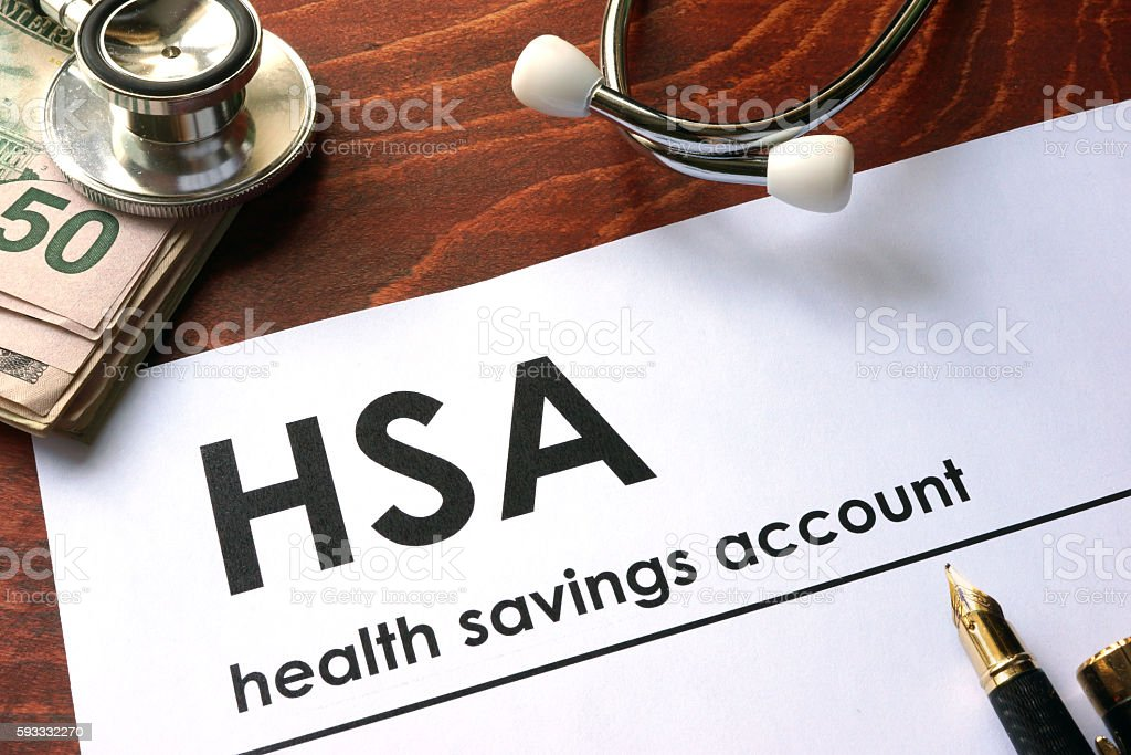Paper with words  health savings account (HSA) on a table. stock photo