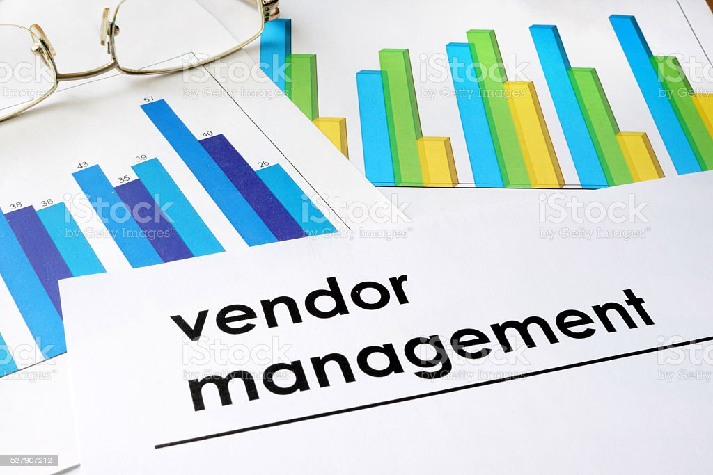 Paper with words Vendor management and charts. stock photo