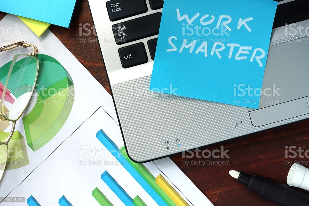 Paper with work smarter on the notebook. stock photo