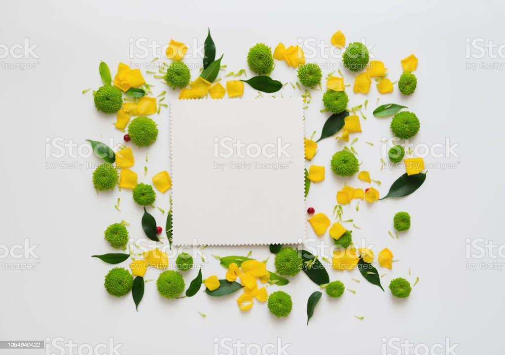 Paper with wreath frame from roses and chrysanthemum flowers, ficus...