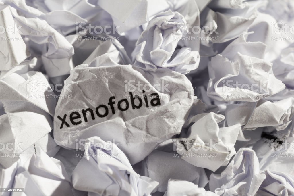 Paper written xenofobia, portuguese and spanish word for xenophobia. Concept of old and abandoned idea or practice. stock photo