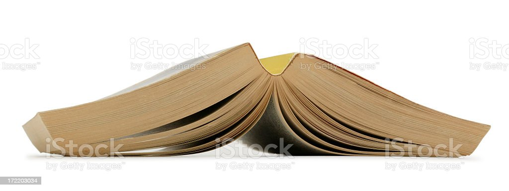 Paperback book open and turned upside down on white background stock photo