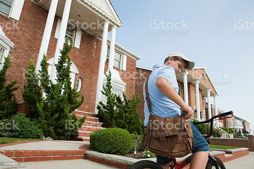 Paperboy with bike delivering newspapers stock photo