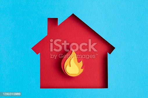 Papercut house with fire inside. Home insurance, security, safety, damage, accident prevention concept