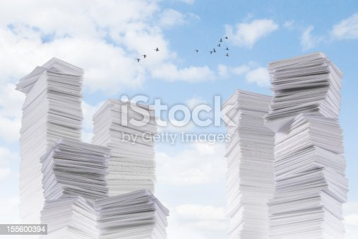 A mountain range of paper. Or symbol of building skyline.