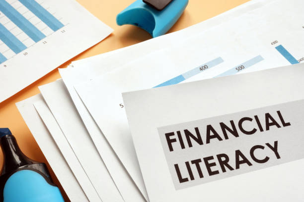 papers about financial literacy with business graphs. - правописание стоковые фото и изображения