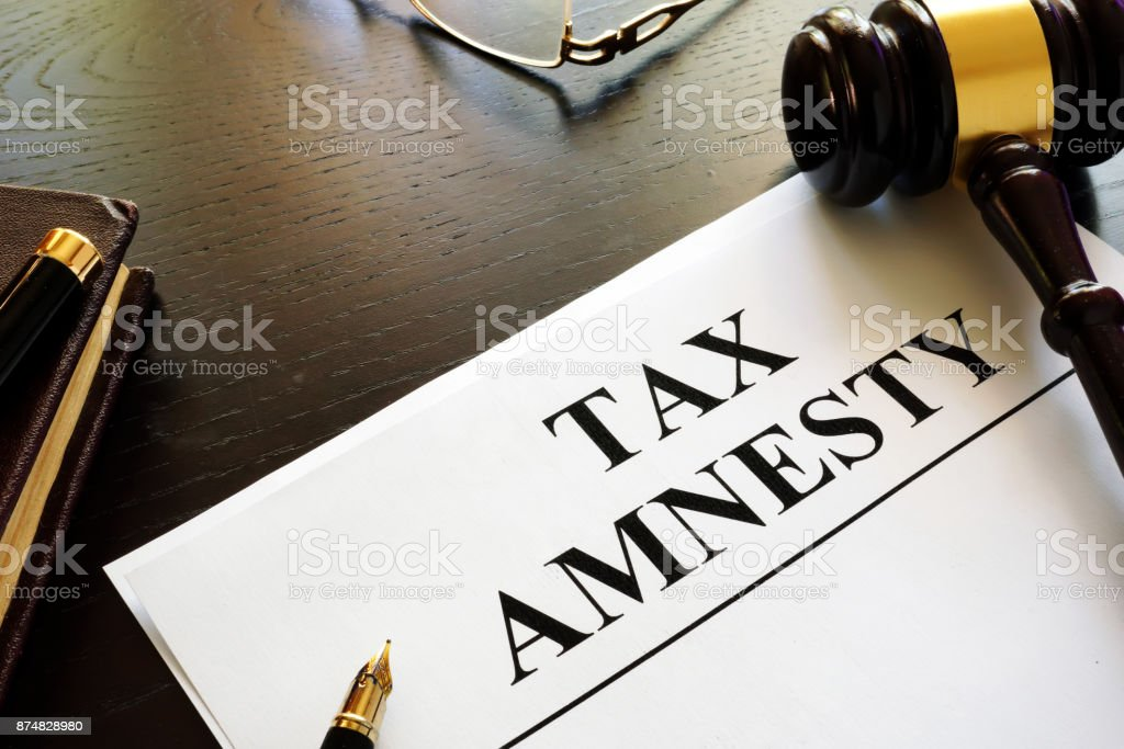 Papers about tax amnesty and gavel in a court. stock photo
